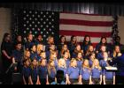The Skyland Singers of Skyland Elementary perform 'Star Spangled Banner' during a special lunch program.