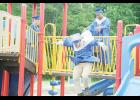 Graduating seniors exit a playground at Wellford Elementary last Friday after a group photo.