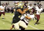Greer stiff-armed Woodruff last Friday night during a 56-0 blowout. The Yellow Jackets move to 4-1 on the season heading into region play.