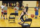 Jay Estes practices a drill during Yellow Jacket Basketball Camp last week at Greer High School.