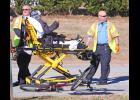 A woman was transported to the hospital following a collision in front of Sunnyside apartments last Friday morning.  The woman was on her bike when she was reportedly struck by a car.  She was conscious when EMTs wheeled her from the scene.