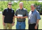 Celebrating Northwood: The Greer Citizen recently presented a check for $600 to Northwood Little League following the team's Little League World Series run last year. The money was raised by local businesses and was donated to the families of the championship team. Pictured left to right are coach Kevin Tumblin, Jody Parker and Steve Blackwell (The Greer Citizen).