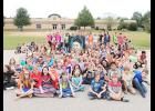 Mountain View Elementary fifth graders gathered on the playground during Superhero Day to remember their late classmate, Skyla Forcier.