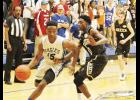 The Eastside boys used a late surge to storm past Greer last Friday night, knocking off the Yellow Jackets, 65-35.