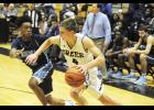 Sam Gravley and the Yellow Jacket boys basketball team fell short against Class AAAAA powerhouse Dorman last week. Greer will continue its difficult stretch of games this week as they take on TC Roberson and Byrnes.
