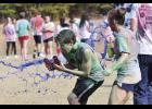 Riverside High School students participate in a 'Paint War' following an America-themed 5K on Tuesday morning. Both events were part of spirit week activities created to raise $70,000 for Camp Courage.
