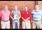 Blue Ridge High's Zaine Lemons was named The Greer Citizen/Owens Insurance Defensive Player of the Week during Week 3. Pictured left to right are: Chris Crist (Owens Insurance), Lemons, Blue Ridge coach Shane Clark and Shane Lynn (Owens Insurance).