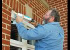Phillip Meredith of Innovative Constructive Services makes repairs at First Presbyterian Church.