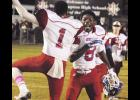Mark James and Antonio McGowan celebrate Riverside's win over Wade Hampton. The victory guaranteed the Warriors a trip to the playoffs.