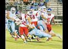 J.L. Mann's defense proved too much for Max Louris and the Riverside Warriors as the team suffered a close loss, 35-33, Friday night.
