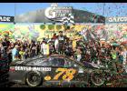 Martin Truex, Jr., driver of the #78 Furniture Row/Denver Mattress Toyota, celebrates in Victory Lane after winning the NASCAR Sprint Cup Series Teenage Mutant Ninja Turtles 400 at Chicagoland Speedway on Sept. 18 in Joliet, Illinois.
