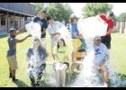 "Challenge accepted: Bonds Career Center teachers Heather Hannon, Anna Chappell and Steve Musco get drenched with cold water doing the ""ALS Ice Bucket Challenge"" in an effort to raise awareness and funds for Amyotrophic Lateral Sclerosis."